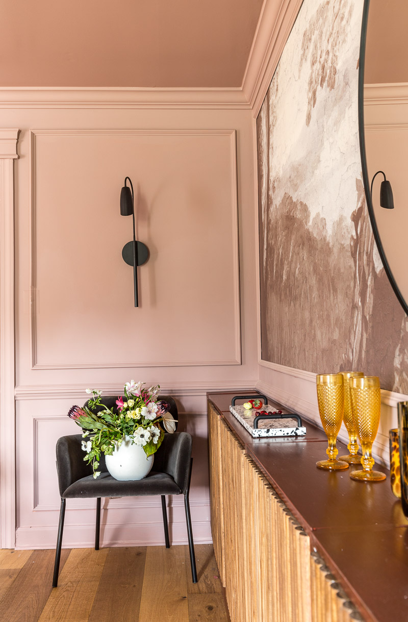 An AMAZING glamorous dining room, makeover, with a tree stump Cambria table, hardwoods, modern crystal chandelier, mural, moulding, Sulking Room Pink , Farrow and Ball, Candace Heil, One Room Challenge, Jewel Marlowe, Jeweled interiors, Fall 2020, Stroheim