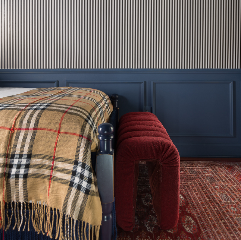 DIY Modern bench, channel tufted, bouclé, wool, red Masculine Traditional Bedroom, reveal, boy's bedroom, boy bedroom, man bedroom, British design, grand millennial, traditional design, Stiffkey blue, black and white striped wallpaper, Milton and king, candy stripe, gallery wall,