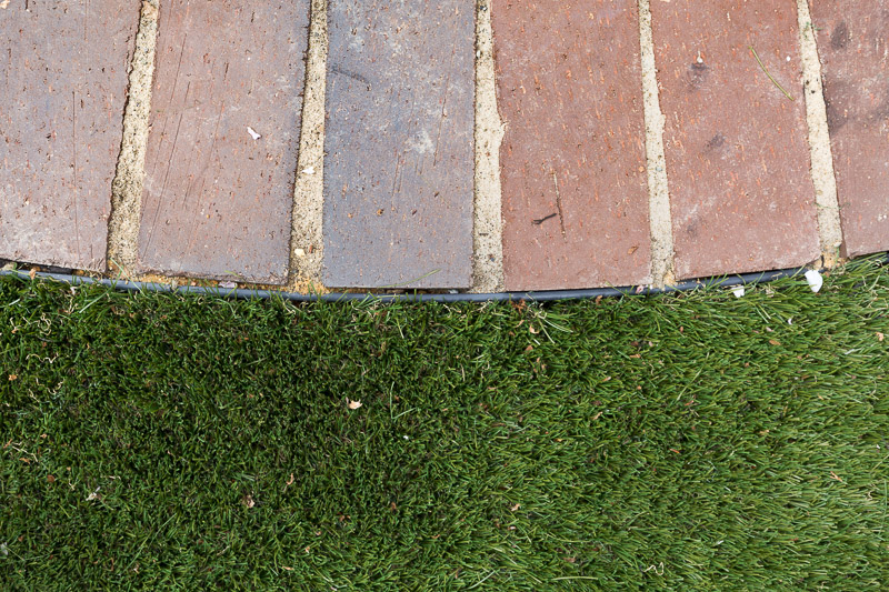 artificial grass, turf, imitation grass, backyard, backyard turf, back yard, makeover, faux grass, how to install artificial grass, brick