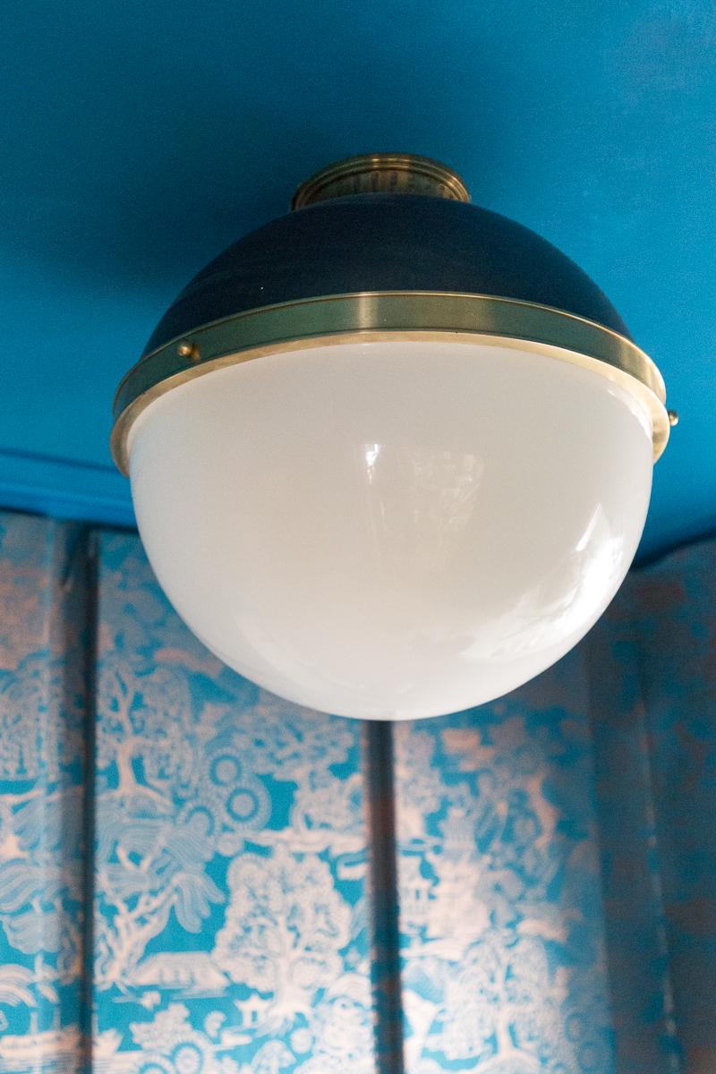 laundry room, wallpapered cabinets, Incredible laundry room lighting, Latham, Hudson Valley Lighting, flush mount, black and brass, semi flush mount
