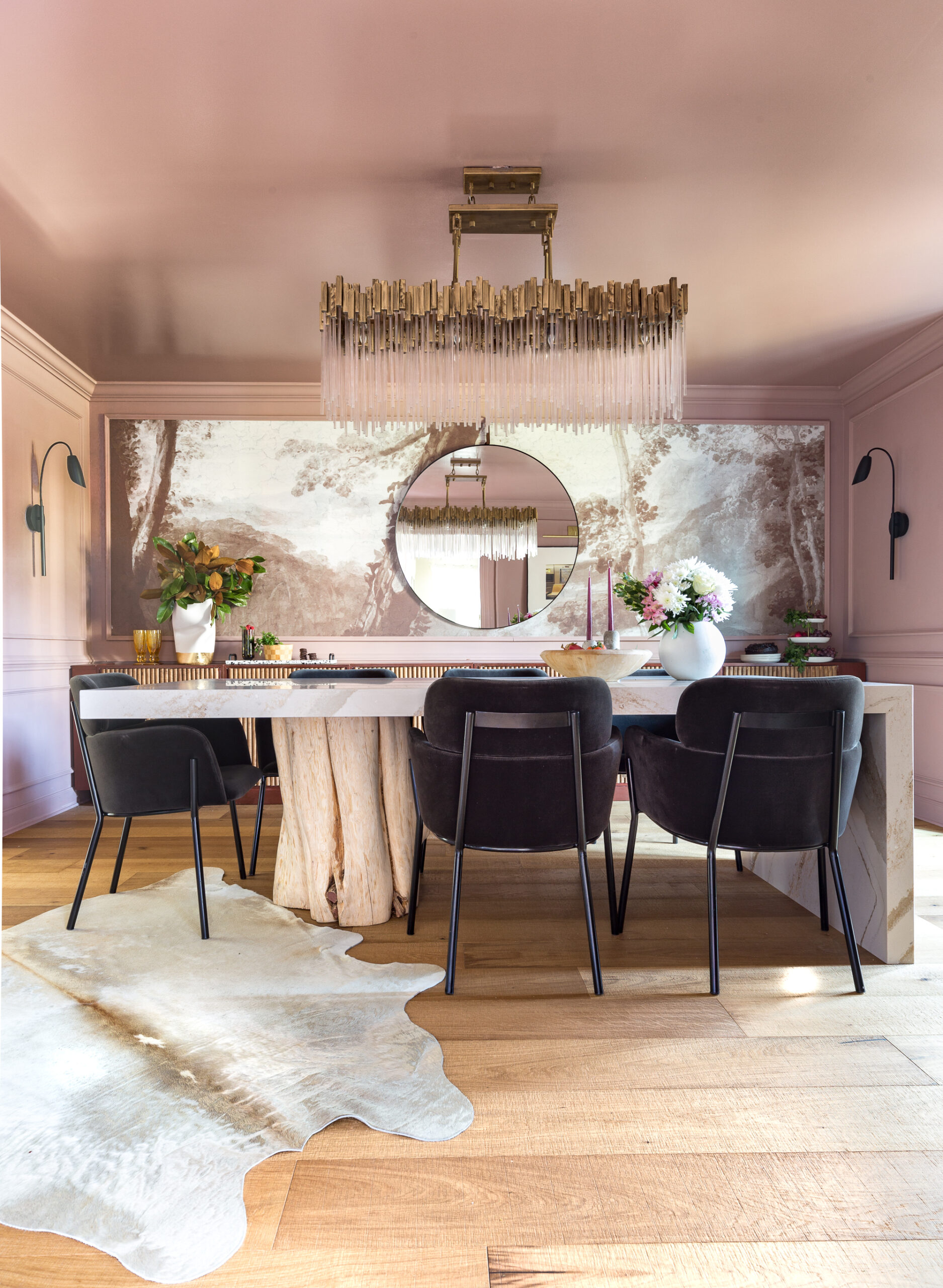 glamorous dining room with tree stump leg and cambria top, waterfall table, sulking room pink