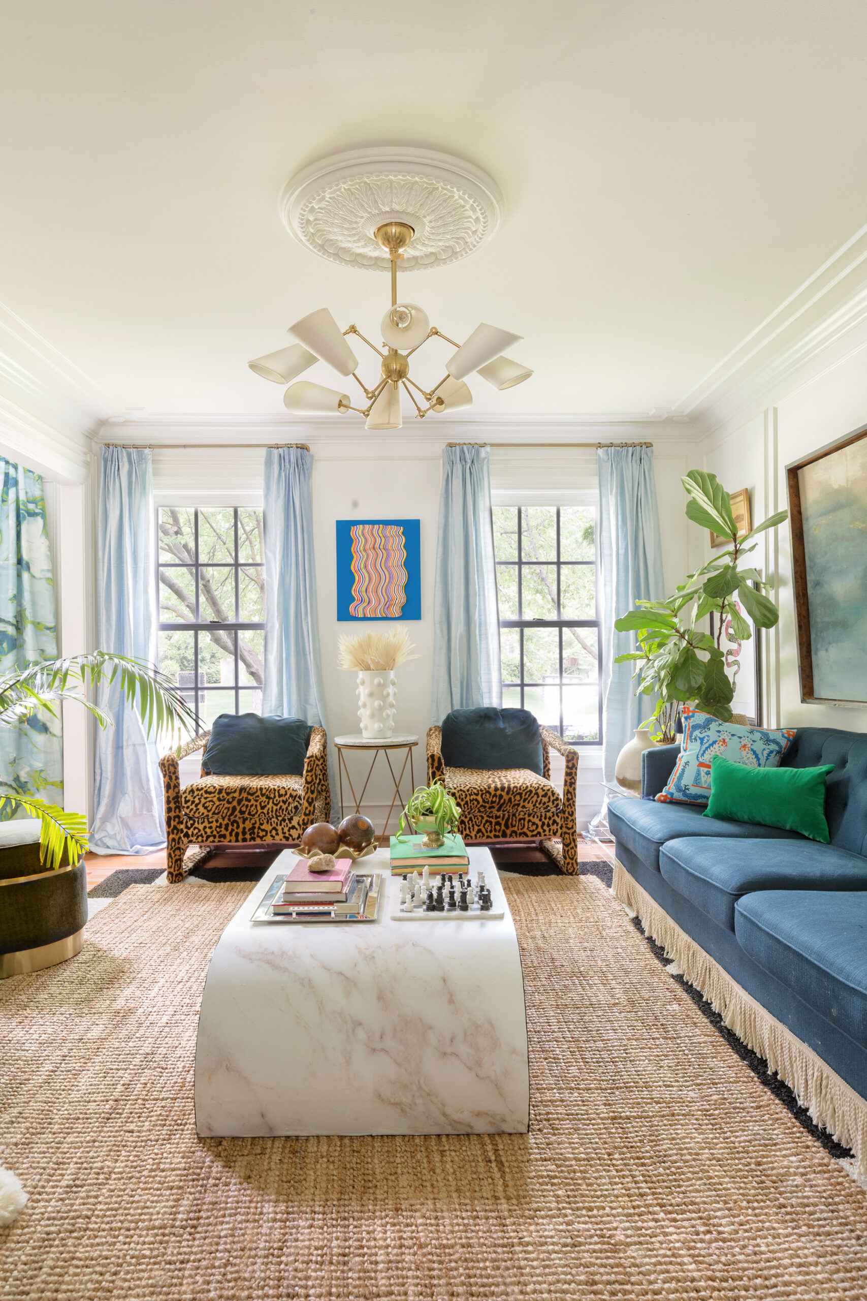 return on art, Derick Smith, Jessica Moritz, laundry room, one room challenge, entryway, leopard carpet, living room, leopard chairs