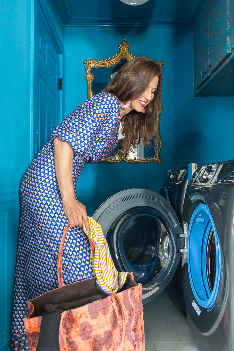 You have to see the updates to this laundry room  Ge, washer and dryer, antimicrobial, no mold, graham and brown wallpaper, small laundry room ideas, teal, wallpaper, laundry room, metallic wallpaper.
